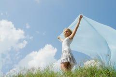 Una muchacha con el azul Imagen de archivo libre de regalías