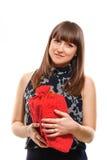 Una muchacha con la caja de regalo roja Fotos de archivo libres de regalías