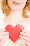 Una muchacha con un corazón Fotografía de archivo libre de regalías