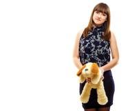 Una muchacha con un perrito del juguete Fotos de archivo