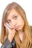 Una muchacha con un teléfono es infeliz Imagenes de archivo