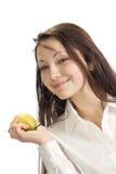 Una muchacha con una fruta en su mano Imagen de archivo libre de regalías