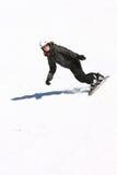 Una muchacha de la snowboard en negro Foto de archivo