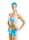 Una muchacha de los deportes con pesa de gimnasia aislada Imagen de archivo