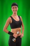 Una muchacha de los deportes en fondo verde Imagen de archivo