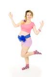Una muchacha embarazada que se coloca con el arco azul Imágenes de archivo libres de regalías