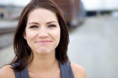 Una muchacha emocional que se defiende los rasgones Imagen de archivo