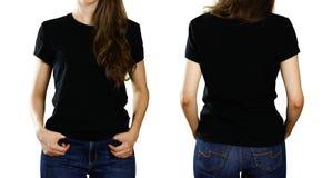 Una muchacha en una camiseta negra vacía Visión delantera y trasera Cierre para arriba Aislado en el fondo blanco imagenes de archivo