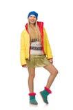 Una muchacha en la ropa brillante del invierno aislada en blanco Imagenes de archivo