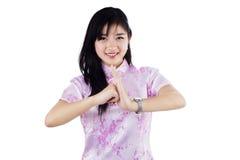 Una muchacha felicita Año Nuevo chino Imágenes de archivo libres de regalías