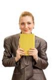 Una muchacha hermosa con un libro Foto de archivo
