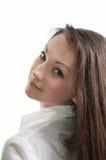 Una muchacha hermosa que mira detrás Imágenes de archivo libres de regalías