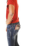 Muchacha adolescente con el teléfono móvil en bolsillo. Imagen de archivo