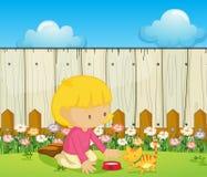 Una muchacha que alimenta el gato dentro de la cerca stock de ilustración