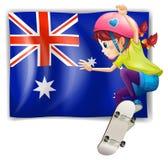 Una muchacha que anda en monopatín delante de la bandera australiana Fotografía de archivo