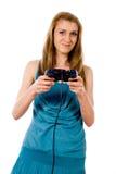 Una muchacha que juega a los juegos video Imágenes de archivo libres de regalías
