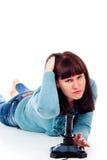 Una muchacha que juega a los juegos video, derrota Foto de archivo