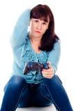 Una muchacha que juega a los juegos video, derrota Fotografía de archivo libre de regalías