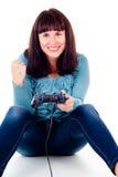 Una muchacha que juega a los juegos video, disfrutando la victoria Imagen de archivo