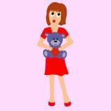 Una muchacha que lleva el vestido rojo con el peluche Imagen de archivo libre de regalías