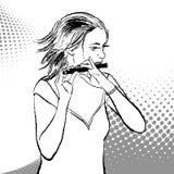 Una muchacha que toca la flauta Imagen de archivo libre de regalías