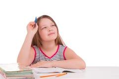 Una muchacha sueña en clase Fondo blanco Imagen de archivo