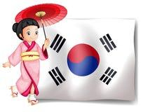 Una muchacha surcoreana al lado de su bandera Fotografía de archivo