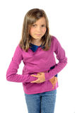 Una muchacha tiene dolor de estómago fotografía de archivo libre de regalías