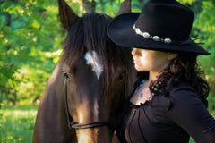 Una muchacha y su serie del caballo Imágenes de archivo libres de regalías