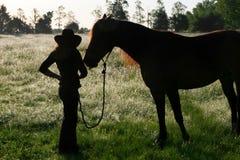 Una muchacha y su serie del caballo Imagen de archivo libre de regalías