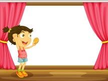 Una muchacha y una ventana Foto de archivo libre de regalías