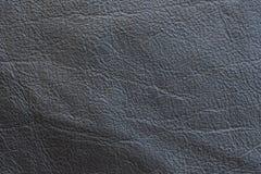Una muestra de paño de cuero negro para coser Fotografía de archivo