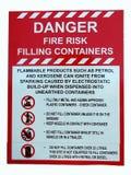 Una muestra que muestra el peligro del riesgo de fuego al archivar los envases foto de archivo
