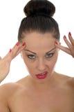 Una mujer caucásica joven hermosa muy subrayada tirando de las caras Foto de archivo libre de regalías