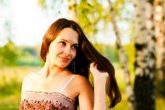 Una mujer con el pelo que fluye Fotografía de archivo libre de regalías