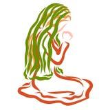 Una mujer con un pañuelo en su cabeza ruega a dios, arrodillándose