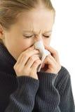 Una mujer de estornudo Imágenes de archivo libres de regalías