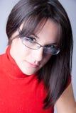 Una mujer de negocios hermosa con los vidrios Foto de archivo