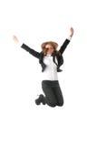 Una mujer de negocios que salta con las manos en el aire Imagen de archivo