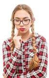 Una mujer de pensamiento joven sana en vidrios Imágenes de archivo libres de regalías