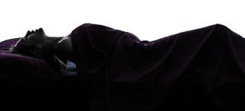 Mujer masturbating en silueta de la cama Imagen de archivo