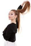 una mujer hermosa con el pelo largo Foto de archivo libre de regalías