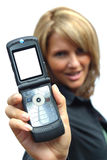 Una mujer hermosa con el teléfono Fotografía de archivo libre de regalías