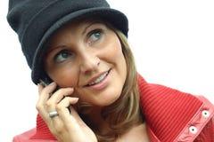Una mujer hermosa con el teléfono Imagenes de archivo