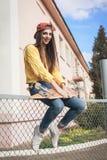 Una mujer hermosa del patinador Fotos de archivo libres de regalías