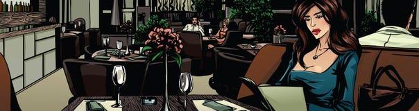 Una mujer hermosa en un restaurante Imagen de archivo libre de regalías