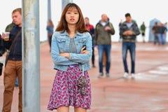 Una mujer japonesa de la audiencia en el festival 2014 del sonido de Heineken Primavera Foto de archivo libre de regalías