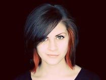 Una mujer joven con el pelo cobarde Foto de archivo libre de regalías