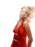 Una mujer joven hermosa con su pelo que sopla y Foto de archivo