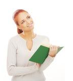 Una mujer joven y feliz del redhead en blanco Foto de archivo libre de regalías